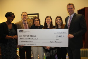 Strawn & Co Agents holding a large check for Haven House